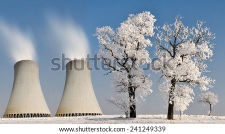 Winter landscape with nuclear power plant. - stock photo