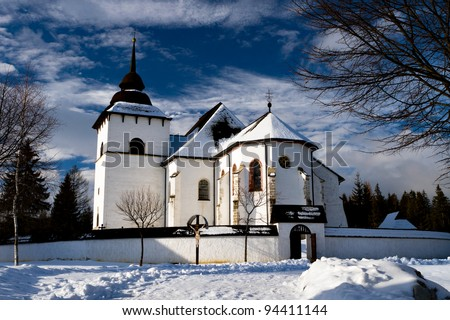 winter landscape with roads and the church. - stock photo