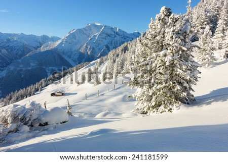 Winter landscape with ski huts - stock photo