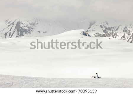 Winter landscape with skiing people. France. Alps. Saint Jean d'Arves.