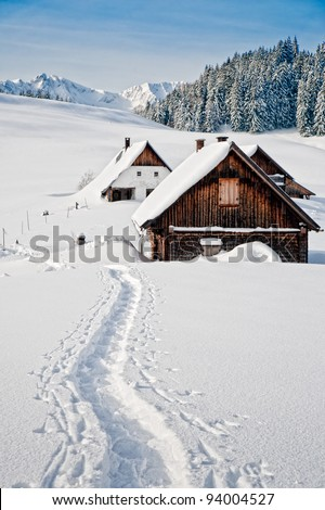 Winter landscape with small hut in the austrian alps