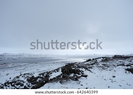winter landscape with snow covered land in Iceland.