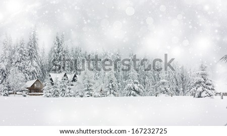 Winter landscape with snowy fir trees and mountain cottage - stock photo