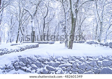 Winter landscape with stones  covered with snow. Fabulous winter city park