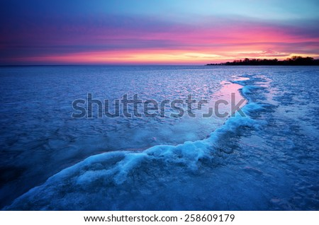Winter landscape with sunset fiery sky. Composition of nature.  - stock photo
