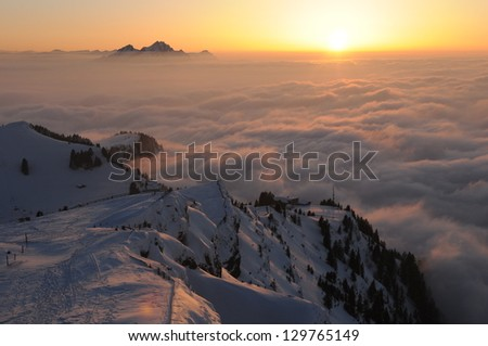 Winter landscape with sunset on the mountain Rigi, in Switzerland - mountain Pilatus is on the background - stock photo