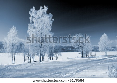 Winter landscape with the river and hoarfrost on trees - stock photo