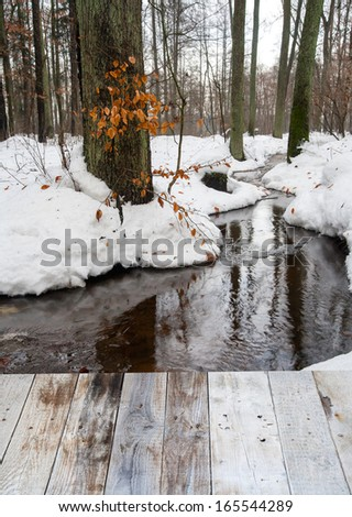 Winter landscape with the river in frosty day and wood floor - stock photo
