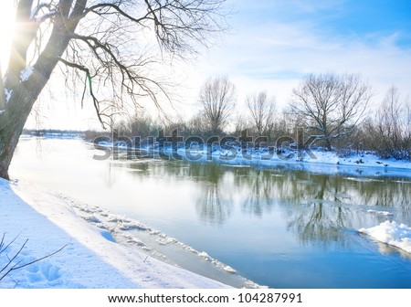 Winter landscape with the river in sunny day