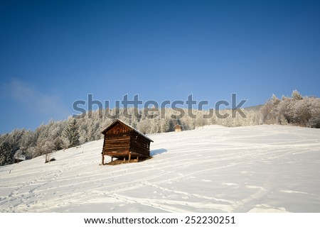 Winter landscape with wooden hut, Pitztal Alps - Tyrol Austria - stock photo