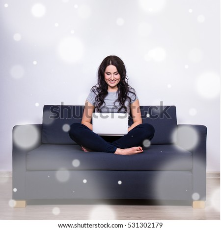winter leisure concept - young woman using computer at home