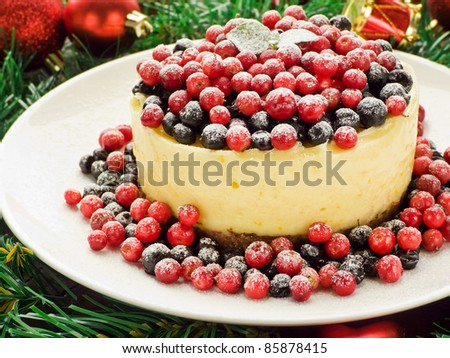 Winter lemon cheesecake with bilberry and cowberry. Shallow dof. - stock photo