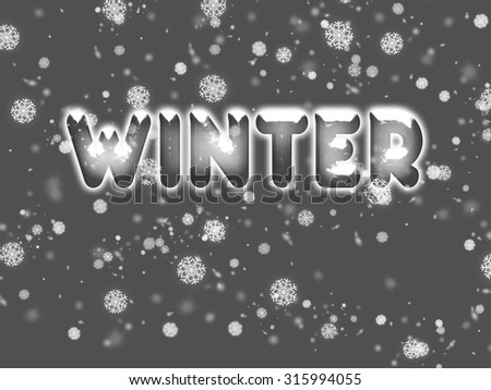 Winter lettering in ice letters with snow on top and with snowfall  - stock photo