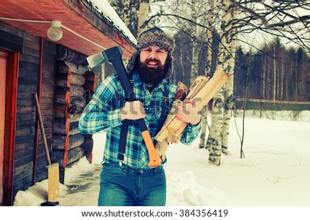winter man axe wood - stock photo