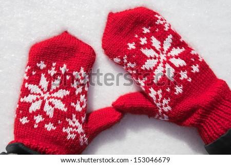 winter mittens on snow - stock photo