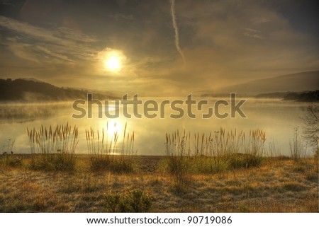 Winter morning fog on the lake - stock photo