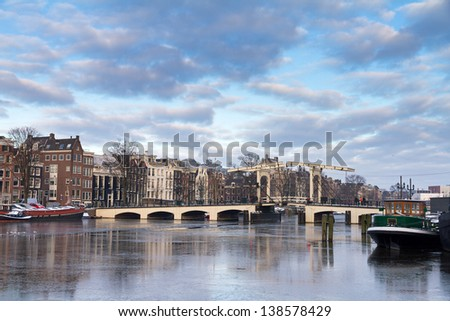 Winter morning image of the skinny bridge over the river Amstel in Amsterdam, the Netherlands - stock photo