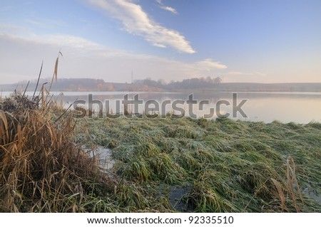Winter morning on a lake - stock photo