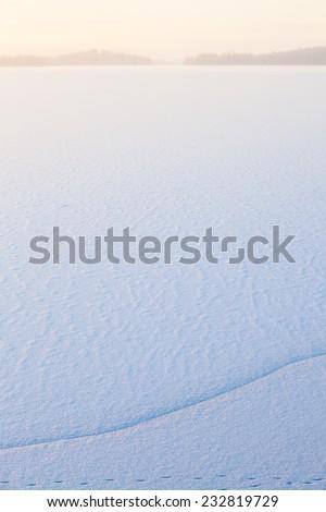 Winter morning view to frozen lake - stock photo