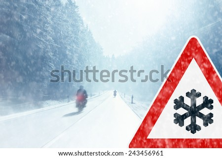 Winter Motorcycling - Caution - stock photo