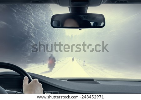 Winter Motorcycling - View from the inside of a car. - stock photo