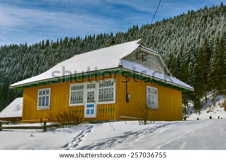winter Mountain chalet in the Carpathians Ukraine - stock photo