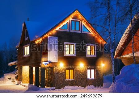 winter mountain house - stock photo