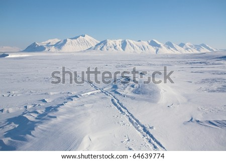Winter mountain landscape - ski tracks - stock photo
