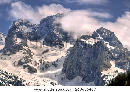 Winter mountain landscape. View of Hoher Dachstein from the lake Vorderer Gosausee. - stock photo