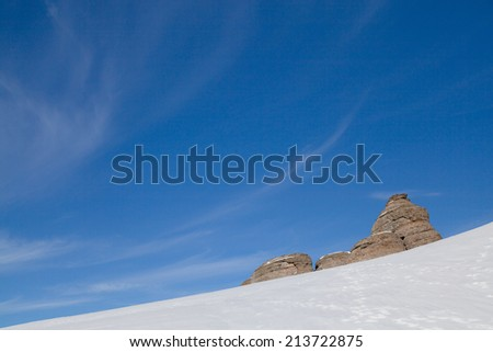 Winter mountain landscape with clouds - stock photo