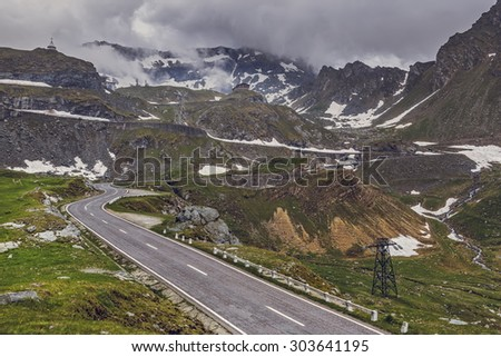 Winter mountain landscape with famous winding Transfagarasan road in Fagaras mountains, Romania. - stock photo