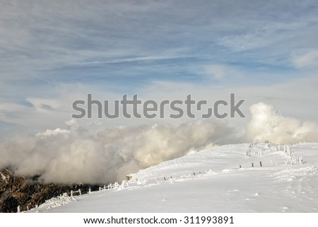Winter mountain landscape with snow fields in Austrian Alps - stock photo