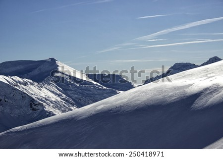 Winter mountain peak in the sunny day. - stock photo