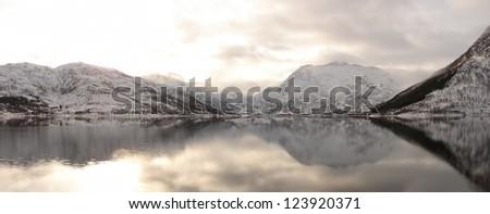 Winter mountain reflections - stock photo