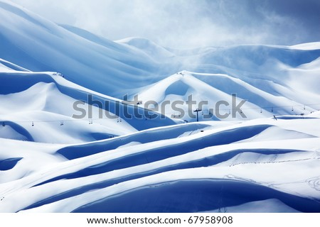 Winter mountain ski resort landscape with snow and chairlift