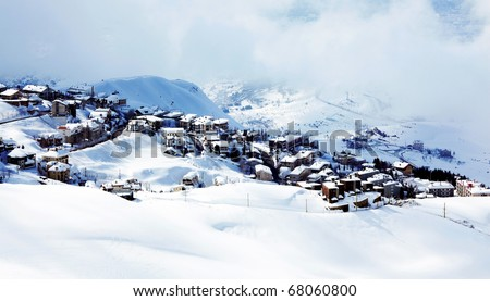 Winter mountain village landscape with snow and cute little houses, beautiful nature panoramic background - stock photo