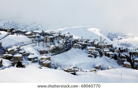 Winter mountain village landscape with snow and cute little houses, beautiful nature panoramic image - stock photo