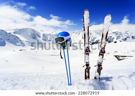 Winter mountains and ski equipments on ski slope - stock photo