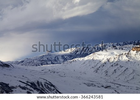 Winter mountains at evening and sunlight clouds. Greater Caucasus, Mount Shahdagh. Qusar rayon of Azerbaijan. - stock photo