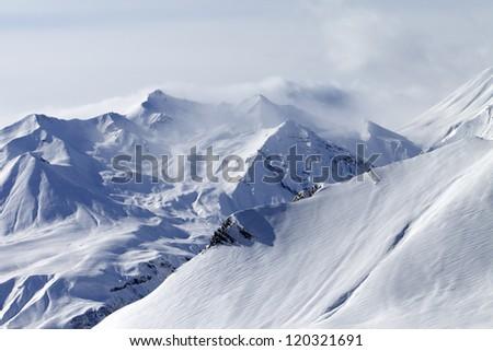 Winter mountains in fog. Caucasus Mountains, Georgia, ski resort Gudauri. - stock photo