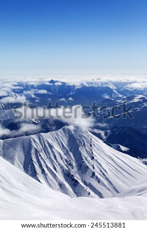 Winter mountains in nice sun day. Caucasus Mountains, Georgia, Gudauri. View from off-piste slope. - stock photo