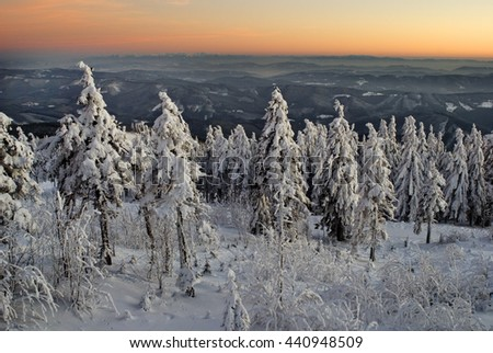 Winter mountains landscape during sunset.
