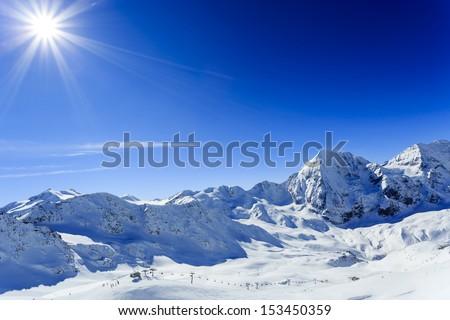 Winter mountains, ski run in Italian Alps - stock photo