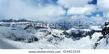 Winter mountains. Snowy slopes at skiing resort - stock photo