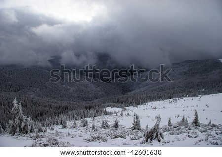 Winter mountains with approaching snowstorm - stock photo