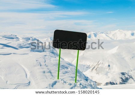 Winter mountains with blank sign - stock photo