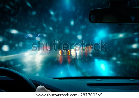 Winter Night Driving - stock photo