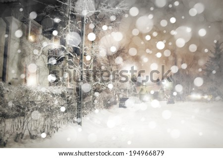 Winter night landscape, snowfall and street lights. - stock photo