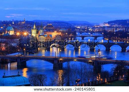 Winter night Prague City with its Bridges above River Vltava, Czech Republic - stock photo