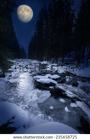 winter night scenery -  mountain river and moon - stock photo